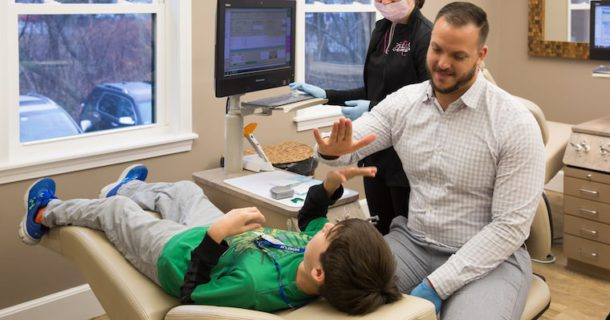 Dr giving a young patient a high five